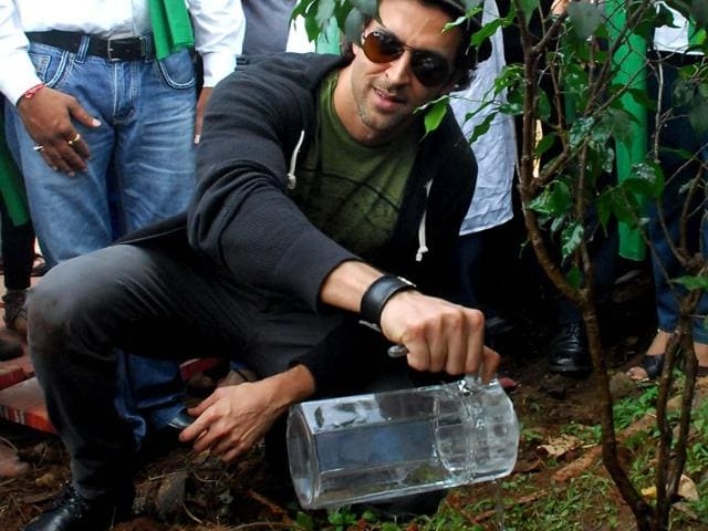 Hrithik Roshan poses during a tree planting of the Clean India campaign in Mumbai on October 2, 2014. (AFP Photo)