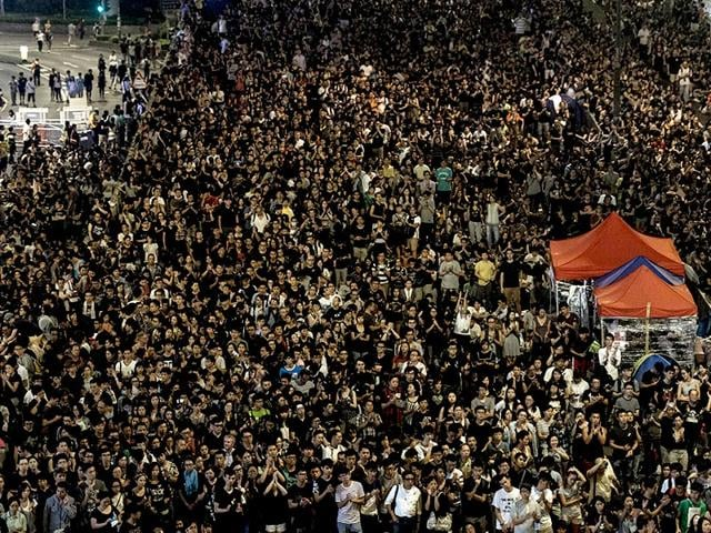 Pro-democracy demonstrators gather for a night rally in Hong Kong. (AFP Photo/Anthony Wallace)