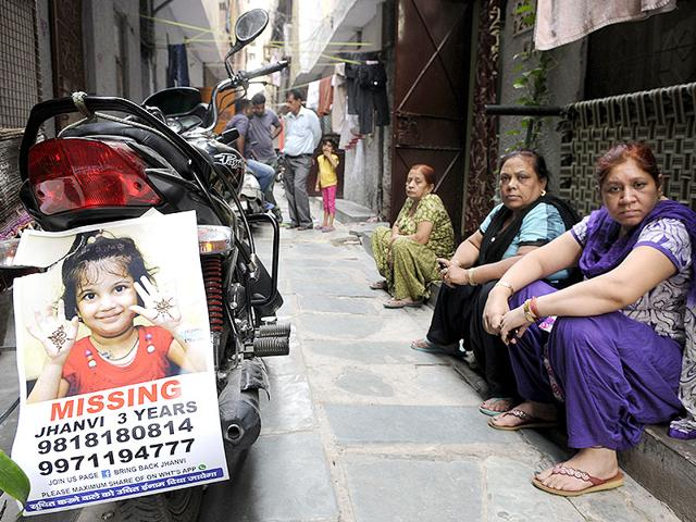 The-relatives-and-friends-of-Jhanvi-a-three-year-old-girl-who-went-missing-from-the-India-Gate-on-September-28-at-her-residence-at-Raghubir-Nagar-in-New-Delhi-Sushil-Kumar-HT-Photo