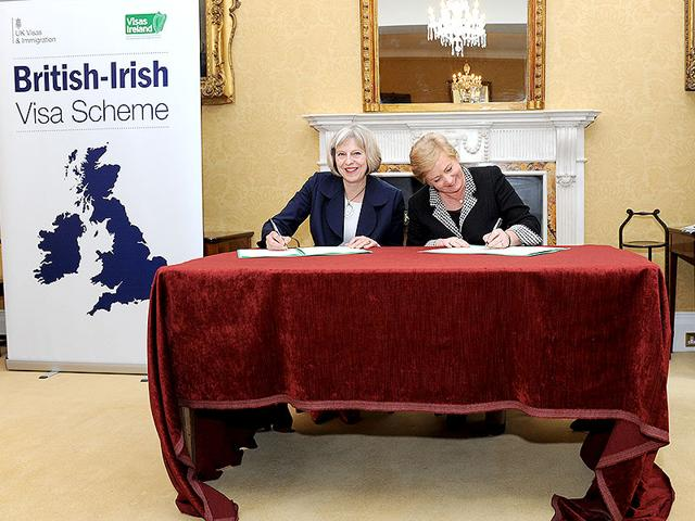 British-home-secretary-Theresa-May-and-Ireland-minister-for-Justice-and-Equality-Frances-Fitzgerald-signing-an-agreement-for-joint-visas-to-Indias-and-Chinese-tourists-and-business-visitors-Agencies