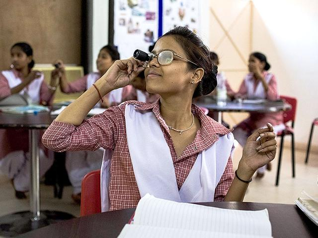 A-student-uses-a-vision-aid-and-glasses-to-simulate-low-vision-as-she-takes-part-in-a-lesson-during-the-Dr-Shroff-Charity-Eye-Hospital-Certified-Ophthalmic-Personnel-COP-training-programme-in-New-Delhi-AFP-Photo