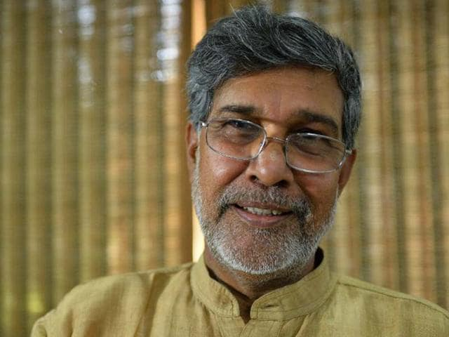 Kailash-Satyarthi-gestures-for-photographers-at-this-home-office-after-the-announcement-of-him-receiving-the-Nobel-Peace-Prize-in-New-Delhi-AFP-Photo