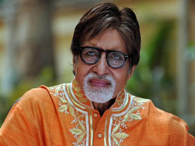 Amitabh-Bachchan-gestures-to-the-audience-as-he-stands-in-front-of-a-poster-of-his-TV-fiction-series-Yudh-in-New-Delhi-AP-Photo