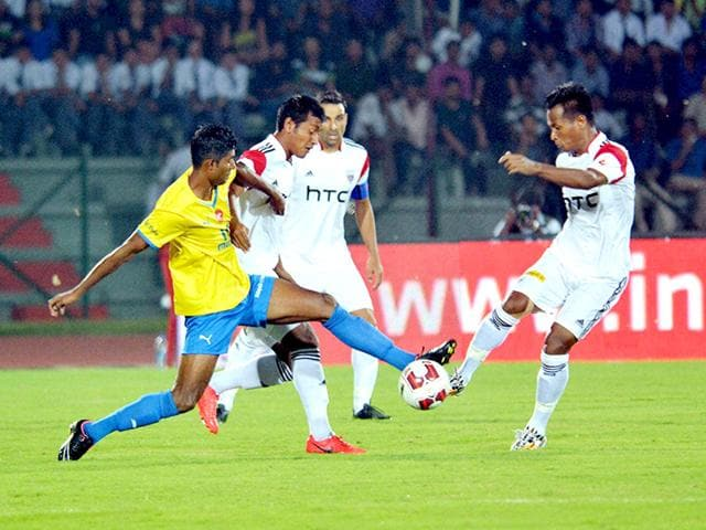 Players-in-action-at-the-Indian-Super-League-ISL-football-match-between-NorthEast-United-FC-white-and-Kerela-Blasters-FC-at-Indira-Gandhi-Athletic-Stadium-in-Guwahati-PTI-Photo