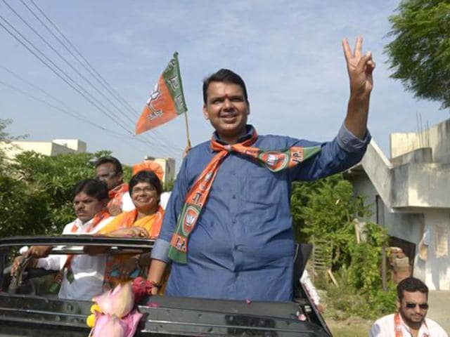 BJP-workers-celebrate-the-party-s-victory-in-Maharashtra-assembly-polls-wearing-masks-of-state-president-Devendra-Fadnavis-PTI-photo