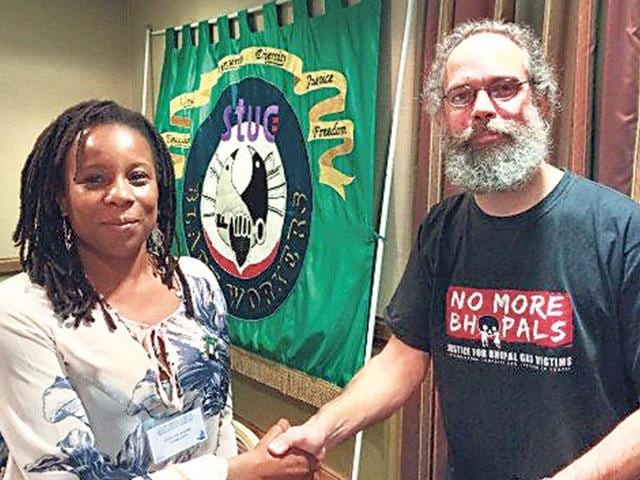 Eurig-Scandrett-of-Scottish-Friends-of-Bhopal-right-with-chairperson-of-Black-Workers-Conference-of-SUTC-Gozie-Joe-Adigwe-after-passing-a-resolution-backing-Bhopal-s-three-decade-long-struggle-for-justice-at-Scotland