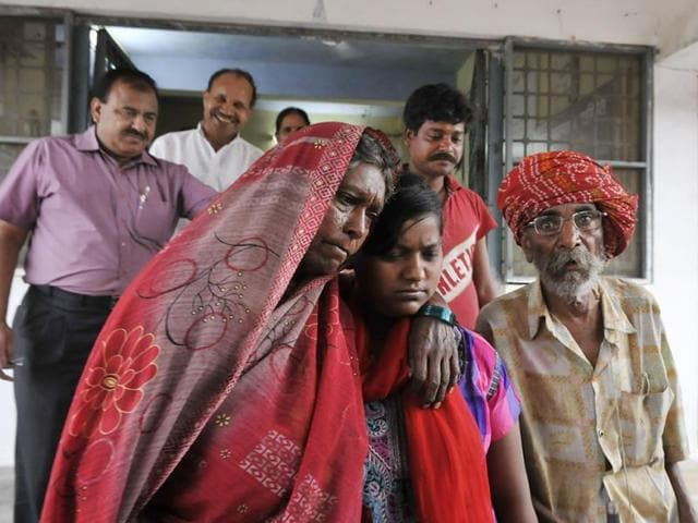 Riya-with-her-aunt-uncle-and-cousin-after-she-was-handed-over-to-them-by-Child-Welfare-Committee-in-Bhopal-on-Friday-Mujeeb-Faruqui-HT-photo