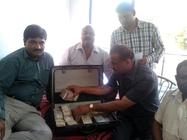 Lokayukta-officials-prepare-an-inventory-of-items-seized-during-the-raid-at-assistant-excise-commissioner-Naval-Singh-Jamod-s-residence-in-Indore-on-Friday-HT-photo
