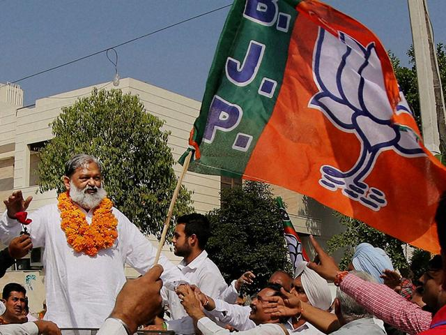BJP candidate Anil Vij takes out a victory procession after his win in Assembly polls in Ambala on Sunday. (PTI Photo)