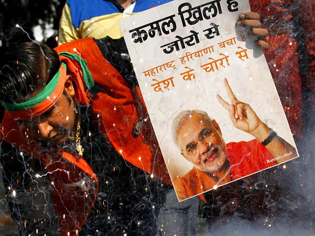 BJP-workers-usher-in-an-early-Diwali-celebarting-their-win-in-front-of-the-party-headquarters-at-Akbar-Road-Delhi-HT-Photo-Sushil-Kumar