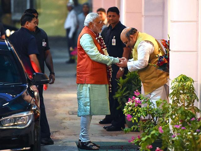 Prime Minister Narendra Modi is greeted by BJP President Amit Shah as Modi arrives at the party headquarters to attend the BJP Parliamentary Board meeting in New Delhi. (AFP Photo)