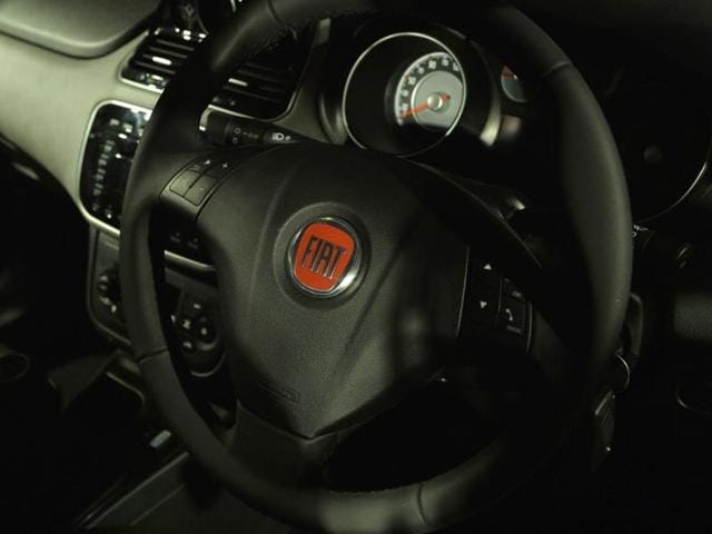 The interior of a Fiat Avventura is pictured during an unveiling in New Delhi on October 21, 2014. The Avventura will be available in petrol and diesel versions with prices starting from 600,000 rupees (9,800 USD). India must urgently improve its infrastructure and reform its tax, land acquisition and labour laws if it is to fulfil its ambition of becoming a leading international automotive manufacturing hub, global carmakers said in September. Photo: AFP