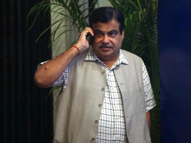 Union-transport-minister-Nitin-Gadkari-takes-a-break-to-speak-with-Prime-Minister-Narendra-Modi-on-mobile-during-CII-National-Council-Meeting-in-Mumbai-Photo-by-Kunal-Patil-HT