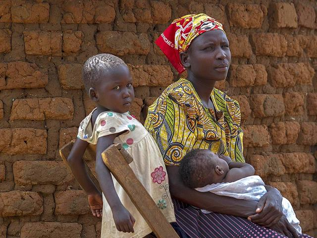 Rose-Akurut-a-26-year-old-mother-of-five-sits-outside-her-father-s-family-home-in-Bukedea-district-after-she-was-chased-away-by-her-husband-who-is-now-demanding-a-refund-of-the-bride-price-he-paid-for-her-When-Ugandan-farmer-s-daughter-Rose-got-engaged-to-a-man-from-a-village-far-from-her-own-her-parents-could-not-be-more-thrilled-But-the-dowry-she-would-bring-cows-goats-and-cash-soured-the-marriage-and-brought-dark-clouds-over-the-partnership-a-story-repeated-by-many-others-in-Uganda-AFP-Photo