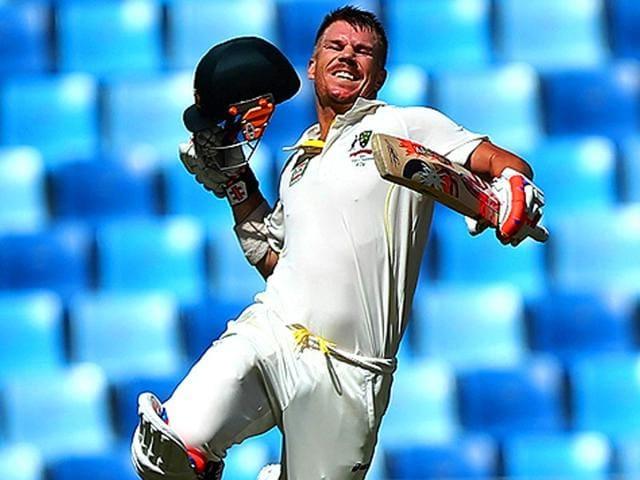 Australian-batsman-David-Warner-celebrates-after-scoring-a-century-his-ninth-test-century-during-third-day-of-the-first-test-cricket-match-against-Pakistan-at-the-Dubai-International-Stadium-AFP-Photo