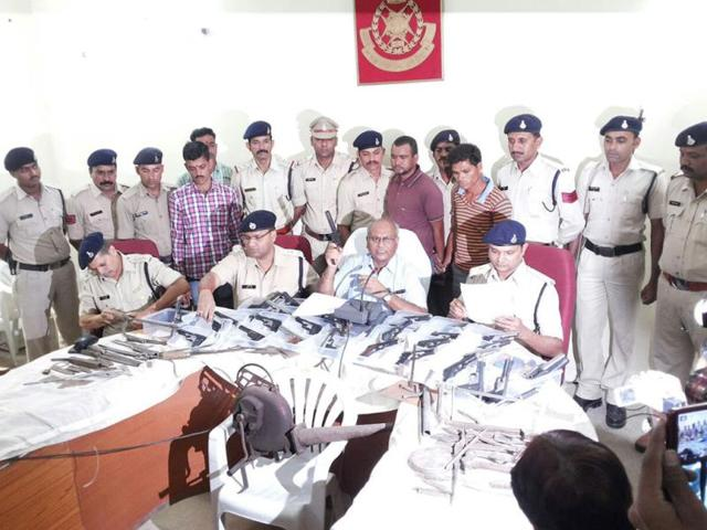 Khargone-range-DIG-DK-Arya-interacts-with-the-media-after-the-police-arrested-two-persons-with-a-huge-cache-of-firearms-HT-photo
