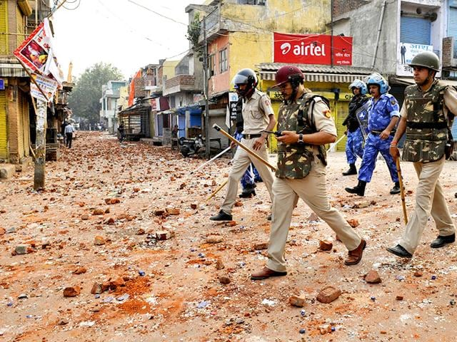 Brickbats-are-seen-at-a-road-in-Trilokpuri-a-day-after-communal-clashes-in-the-area-PTI-Photo