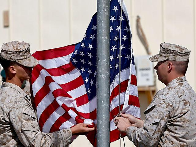 US-Marines-lower-their-flag-during-a-handover-ceremony-as-the-last-US-Marines-unit-and-British-combat-troops-end-their-Afghan-operations-in-Helmand-on-Sunday-Reuters-Photo