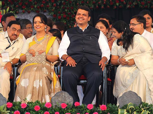Devendra-Fadnavis-along-with-his-wife-Amruta-second-from-left-during-his-swearing-in-ceremony-Fadnavis-passed-his-first-key-test-in-Maharashtra-Assembly-winning-a-trust-vote-Anshuman-Poyrekar-HT-photo