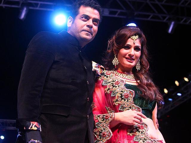 Bollywood-actor-Raveena-Tandon-walks-the-ramp-with-fashion-designer-Asif-Shah-at-his-annual-fashion-show-in-Indore-on-Friday-Shankar-Mourya-HT-photo