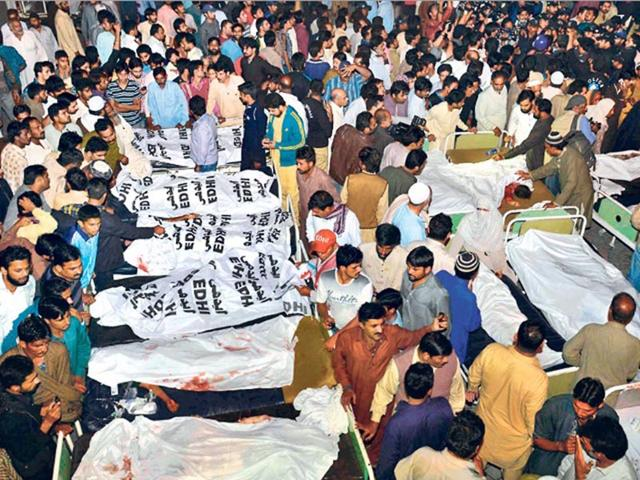 Relatives-gather-beside-the-covered-bodies-of-victims-who-were-killed-in-suicide-bomb-attack-in-Wagah-border-near-Lahore-Reuters-Photo