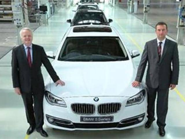 Philipp-von-Sahr-president-of-BMW-India-and-Robert-Frittrang-MD-of-Chennai-plant-with-the-40-000th-locally-produced-car-as-it-rolls-out-of-BMW-Plant-Chennai
