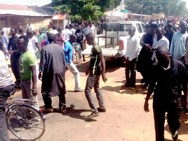 Shiite-faithful-at-the-scene-of-a-suicide-blast-in-the-northeast-Nigerian-town-of-Potiskum-AFP-Photo