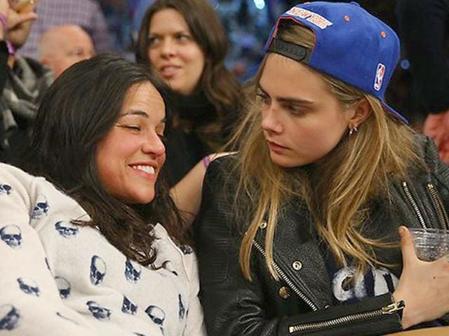 Michelle-Rodriguez--and-Cara-Delevingne-at-a-basketball-game-AFP-Photo