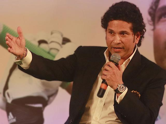 Sachin-shares-a-lighter-moment-with-his-wife-Anjali--during-the-launch-of-his-autobiography-Playing-It-My-Way-in-Mumbai-AP-Photo