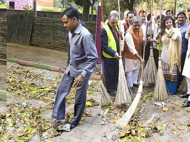 A-combo-picture-shows-workers-spreading-garbage-for-a-cleanliness-drive-that-was-attended-by-Delhi-BJP-chief-Satish-Upadhyay-and-former-AAP-member-Shazia-Ilmi-at-India-Islamic-Centre-in-New-Delhi-PTI-Photo