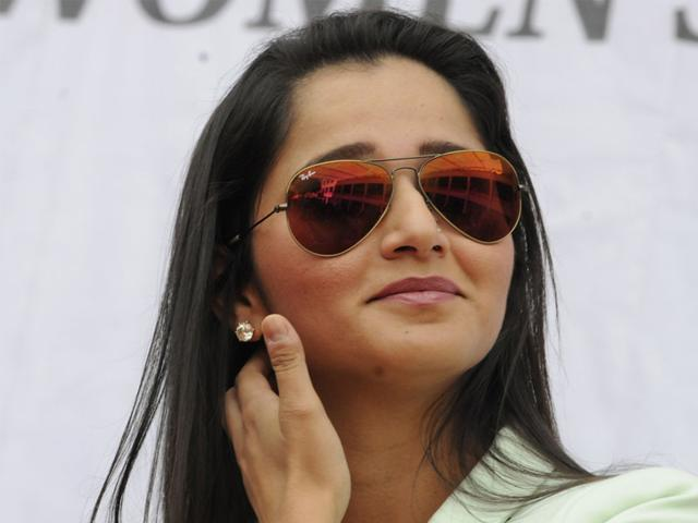 Sania-Mirza-tries-her-hand-at-violin-which-was-played-by-one-of-the-students-of-SDPS-Women-s-College-in-Indore-on-Friday-Amit-K-Jaiswal-HT-photo