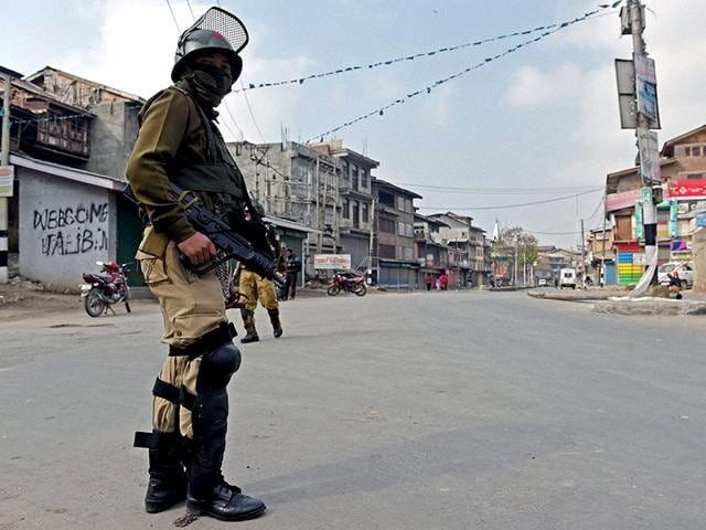 A-security-jawan-stands-guard-during-a-curfew-following-the-killing-of-two-youth-allegedly-in-srmy-firing-in-Srinagar-PTI-Photo