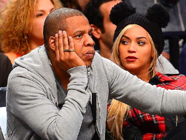 Singing-superstar-Beyonce-Knowles-and-rapper-husband-Jay-Z-watch-a-basketball-match-in-the-US-AFP