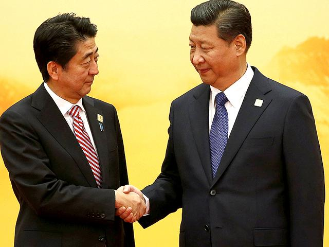 Japan-s-PM-Shinzo-Abe-L-shakes-hands-with-China-s-President-Xi-Jinping-during-a-welcoming-ceremony-of-Asia-Pacific-Economic-Cooperation-APEC-forum-inside-the-International-Convention-Center-at-Yanqi-Lake-in-Beijing-Reuters-Photo
