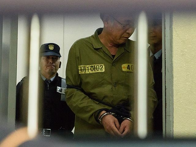 Sewol-ferry-captain-Lee-Jun-Seok-C-is-escorted-after-arriving-at-a-courthouse-in-Gwangju-AFP-Photo