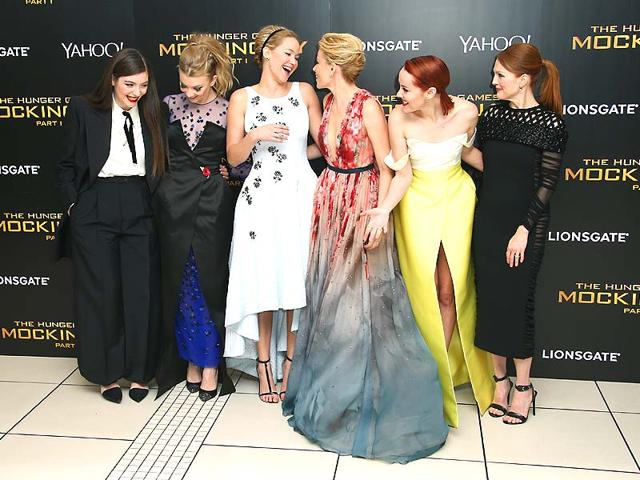 Lorde, Natalie Dormer, Jennifer Lawrence, Elizabeth Banks, Jena Malone and Julianne Moore speak to each other upon arrival to the world premiere of the film The Hunger Games Mockingjay. (Reuters)