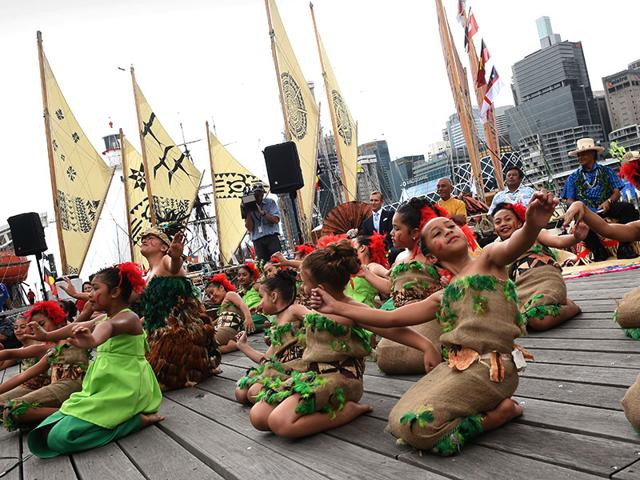 Girls-from-the-pacific-island-nation-of-Tonga-take-part-in-a-traditional-dance-after-arriving-in-Sydney-Traditional-Pacific-island-canoes-sailed-into-Sydney-Harbour-on-after-a-vast-journey-across-the-ocean-bringing-an-urgent-message-to-the-world-about-climate-change-AFP-Photo