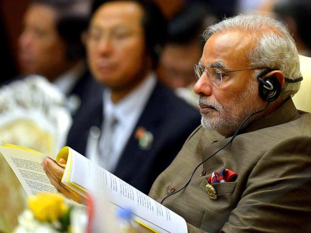 Narendra-Modi-reads-a-document-as-he-attends-the-East-Asia-Summit-Plenary-Session-at-the-Myanmar-International-Convention-Center-in-Myanmar-s-capital-Naypyidaw-AFP-Photo
