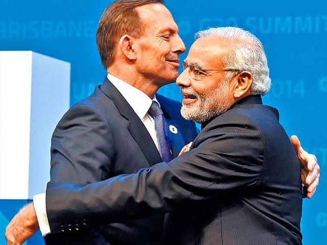 The-hug-shared-by-Modi-and-Australian-PM-Tony-Abbott-was-described-as-the-standout-shake-of-the-summit-AFP-photo