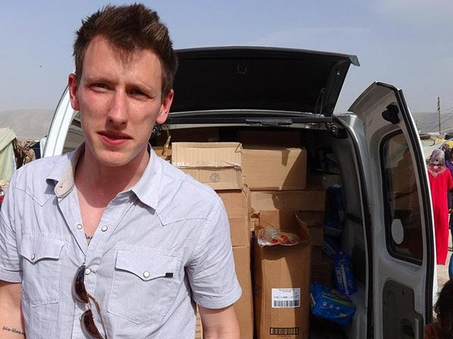 This-handout-photo-released-by-the-Kassig-family-shows-Peter-Kassig-in-front-of-a-truck-somewhere-along-the-Syrian-border-between-late-2012-and-autumn-2013-AFP-Photo