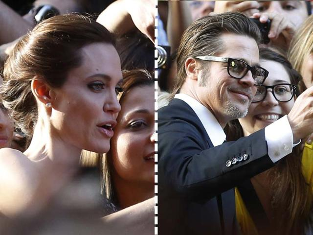 Hollywood-s-first-couple-Angelina-Jolie-and-Brad-Pitt-were-seen-taking-selfies-with-fans-at-the-premier-of-her-upcoming-movie-Unbroken-Reuters-Photos