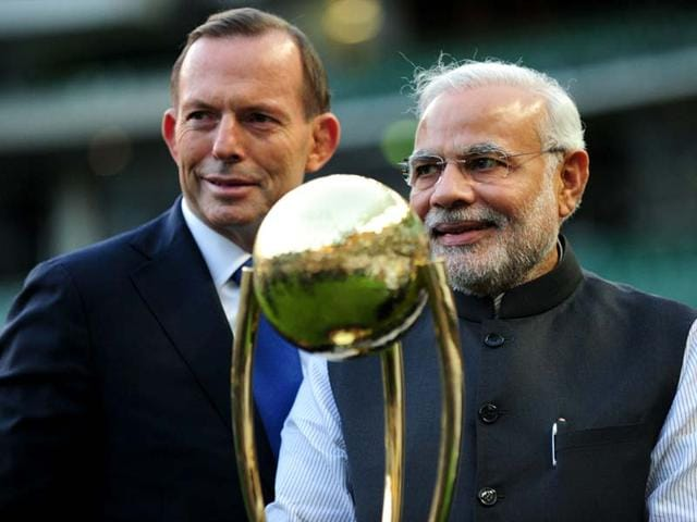 Prime-Minister-Narendra-Modi-and-Australian-prime-minister-Tony-Abbott-poses-with-the-World-Cup-cricket-trophy-during-a-reception-at-the-Melbourne-Cricket-Ground-in-Melbourne-AFP-photo