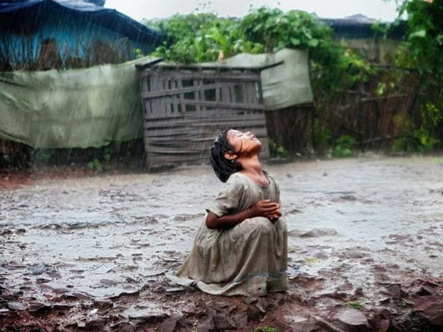 Alex-Masi-s-award-winning-photograph-that-captures-Poonam-Jatev-refreshing-under-the-rain-in-front-of-Union-Carbide-plant-in-Bhopal-Photo-courtesy-Alex-Masi