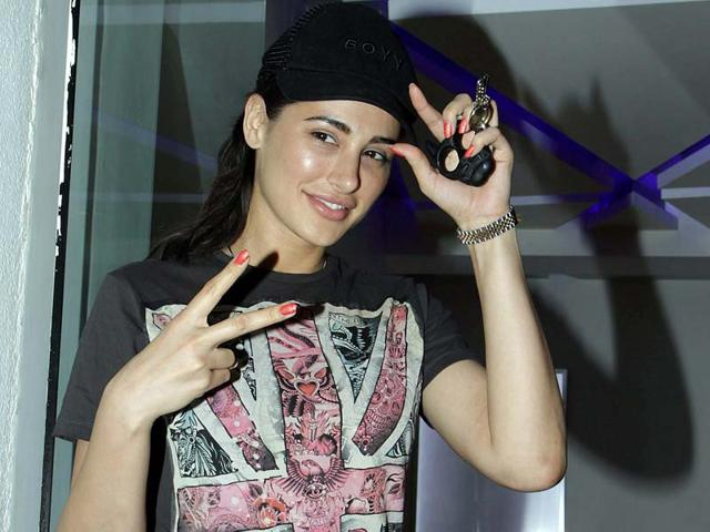 Nargis Fakhri attends the special screening of film Happy Ending in Mumbai on Monday. (PTI Photo)