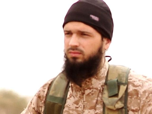 An-image-grab-made-on-November-17-2014-and-taken-from-a-propaganda-video-released-on-November-16-2014-by-Al-Furqan-Media-allegedly-shows-a-member-of-the-Islamic-State-IS-jihadist-group-believed-to-be-French-citizen-Maxime-Hauchard-also-known-as-Abu-Abdallah-Al-Faransi-AFP-Photo-HO