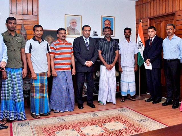 5-Indian-fishermen-who-were-sentenced-to-death-by-the-Colombo-High-Court-with-officials-at-Indian-High-Commission-after-their-release-from-the-prison-in-Colombo-on-Wednesday-for-being-sent-back-to-India-PTI-Photo