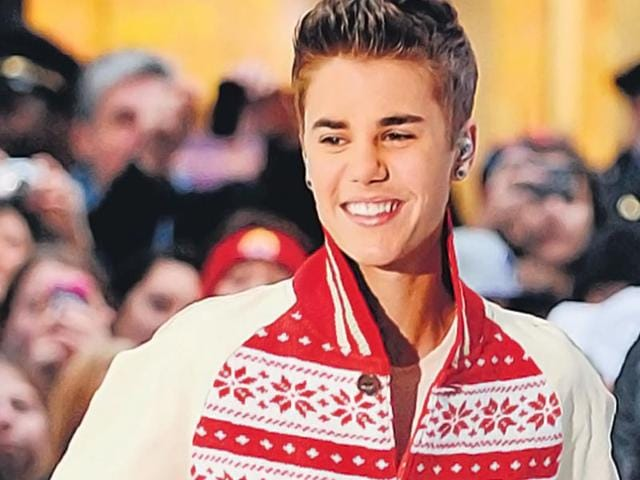 Singer-Justin-Bieber-opts-for-a-varsity-jacket-styled-sweater-in-traditional-festive-hues