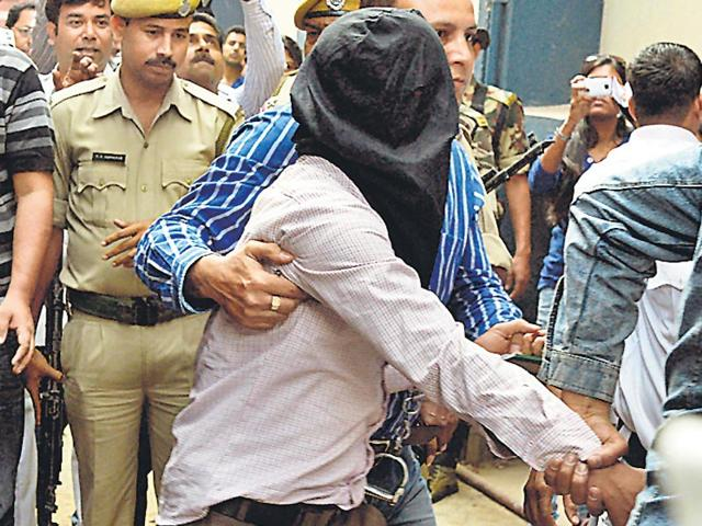 NIA-sleuths-and-West-Bengal-police-escort-Myanmar-national-Khalid-Mohammed-to-Bankshall-court-in-Kolkata-on-Thursday-AFP-Photo
