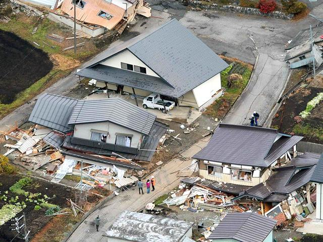 An-aerial-view-shows-collapsed-houses-after-an-earthquake-in-Hakuba-town-Nagano-prefecture-Reuters