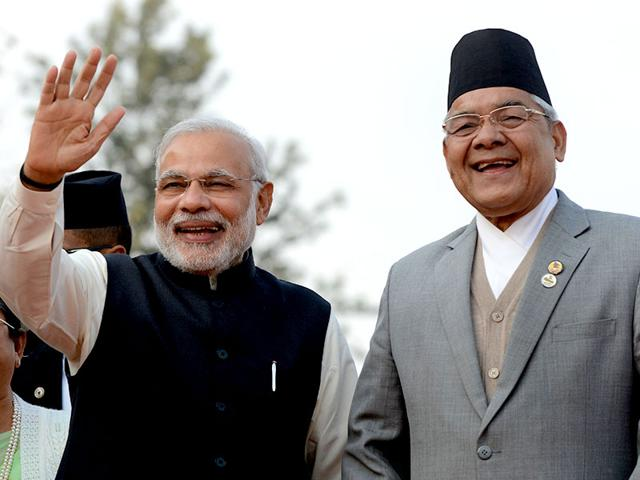 Prime-Minister-Narendra-Modi-waves-as-Nepalese-deputy-prime-minister-and-home-minister-Bam-Dev-Gautam-smiles-on-his-arrival-to-attend-the-18th-South-Asian-Association-for-Regional-Cooperation-SAARC-summit-in-Kathmandu-AFP-photo